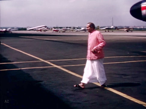 Meher Baba walking to the terminal at Washington, DC. Image captured by Anthony Zois from a film by Sufism Reoriented.