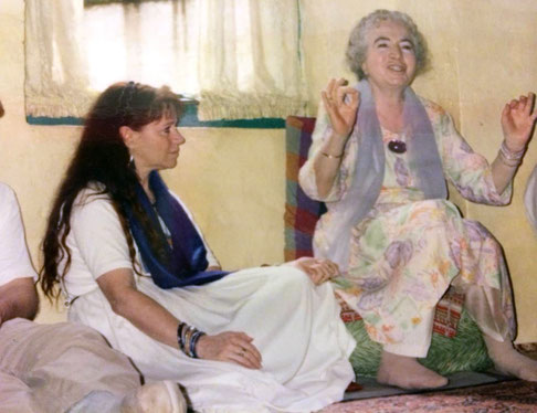 Mandali Hall, Meherazad, India. Mani telling a story with Raine Eastman-Garnett next to her.