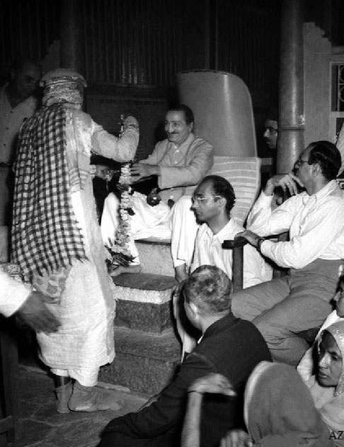 6th Nov. Meher Baba being garlanded by Saint Gadge Maharaj at his Dharamshala in Pandharpur