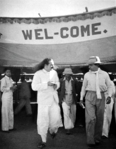 India ; Meher Baba walking with Adi