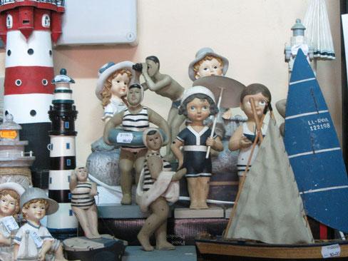 Faros, bañistas, barcos