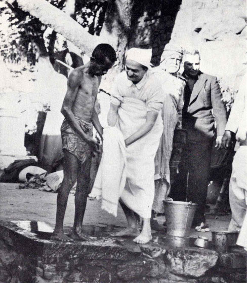"""7th November 1954 : Meher Baba at the leper colony in Pandharpur, drying a leper with Saint Gadge Maharaj & Meherjee Karkaria ( behind Baba ). Photo by B. Panday. Courtesy of N.Anzar's """"The Beloved"""" book - p.72."""