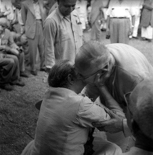 26th September 1954 - Khushru Quarters, Ahmednagar, India. Baba greeting Charles with Adi K Irani standing behind.