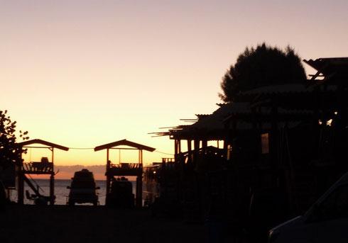Sunrise over palapas in San Felipe