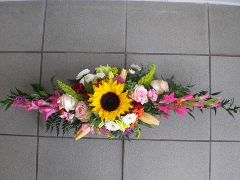 Tischgesteck mit Sonnenblume