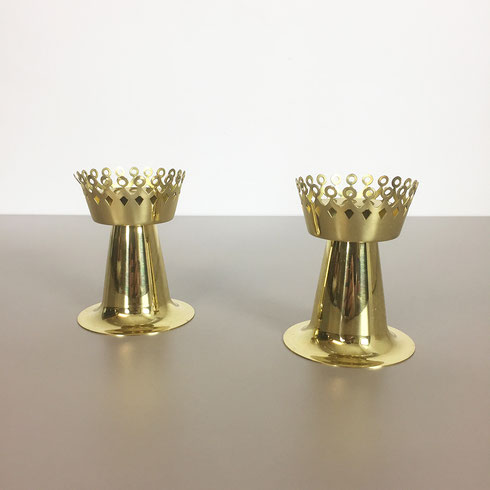 This candlelight holder was designed by Hans Agne Jakobsson in the 1950s and produced by his own company, Hans Agne Jakobsson A. B. in Markaryd, Sweden. This item is made of solid metal in brass. super rare, here as a set of two. the candleholder holders