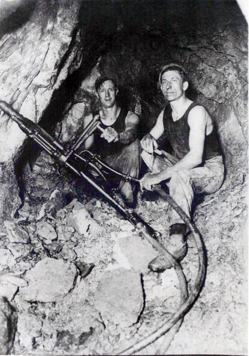 Bill Horton (right) and Tom Dobson drilling charge holes in a Waiuta gold mine in the 1930s (Joe Divis, Hocken Collection)
