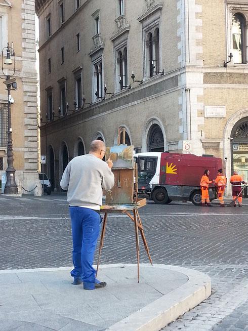 Quando il fervore creativo è irresistibile non si fa caso nemmeno alla confusione di piazza Venezia, come ben dimostra questo anonimo pittore...bravo!