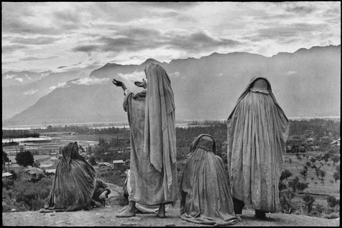 INDIA. Kashmir. Srinagar. 1948. Muslim women on the slopes of Hari Parbal Hill, praying toward the sun rising behind the Himalayas