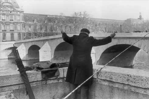 FRANCE. Paris. 1956. Fisherman along the Seine, at the Pont du Carrousel with the Louvre Museum in background.