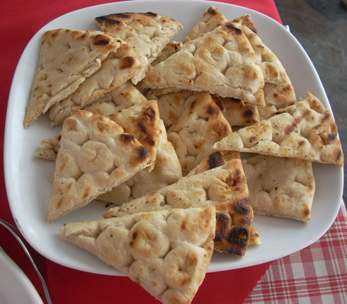 2011 Mykonos - Freshly Baked Pita at Babulos Taverna overlooking Mykonos Harbor