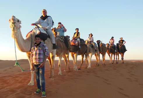 Our Camel Caravan into the Merzouga Dunes at Sunset on a Recent Trip to Morocco