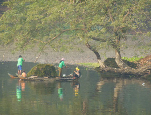2015 Workers clearing weeds from the Bakong Moat during our stay in Cambodia