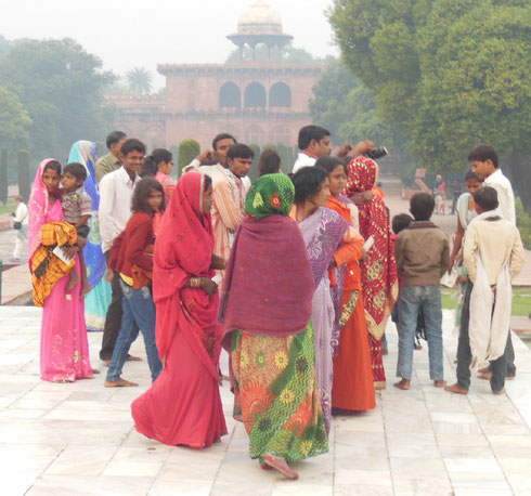 A Group of Pilgrims in Colorful Saris at the Entry Gate to the Taj Mahal