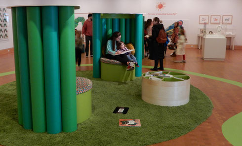 A photo of the galleries in Eric Carle Museum showing seating for parents reading to their children