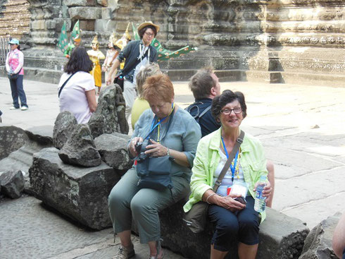 2015 A group of Travelers take a Brief Rest after reaching the Second Level of Angkor Wat