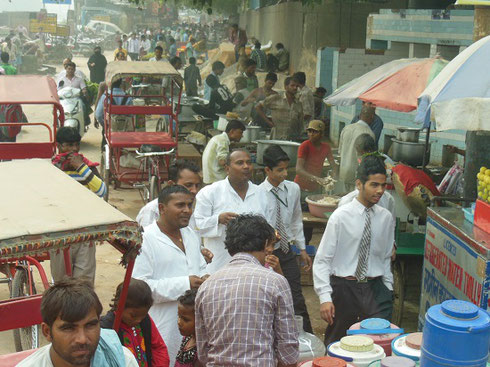 2013 Lunchtime on a street in New Delhi can be quite congested with Rickshaw traffic
