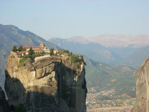 Holy Trinity Monastery in Meteora, Greece is reached by the tiny cable car to left
