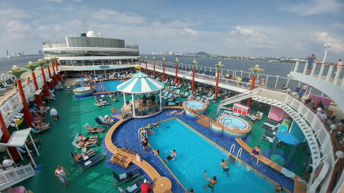 Several Hot Tubs, Pool, Bar, and Cafes can be Found on the Pool Deck