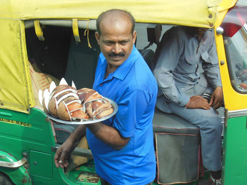2013 New Delhi vendor sells slices of fresh coconut to drivers in stalled traffic