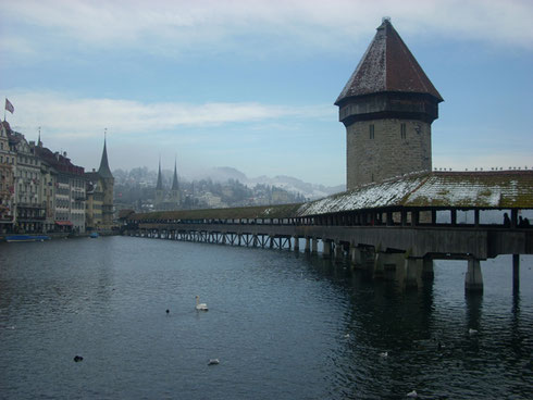 The Foot Bridge and Covered Walkway in Lucerne, Switzerland, Looks Good Even in the Rain