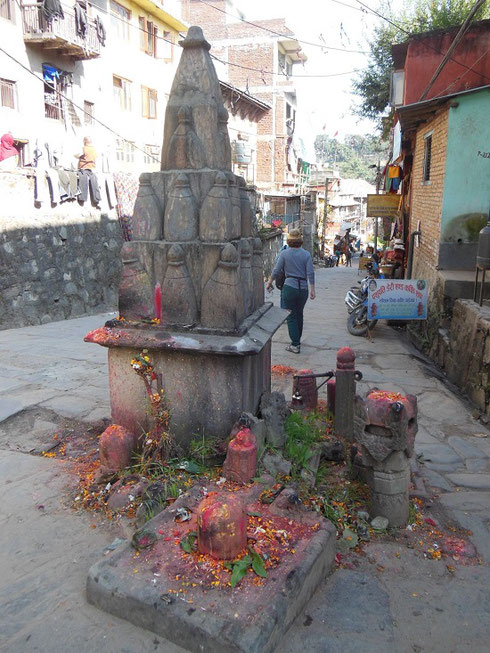 2013 A Linga Stone on a Bhaktapur Street with many Offerings left by the Faithful