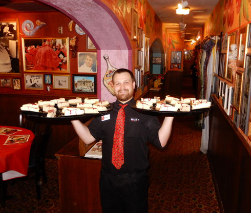 Cheesecake anyone?  Look at the knowing smile on this waiter at Buca di Beppo