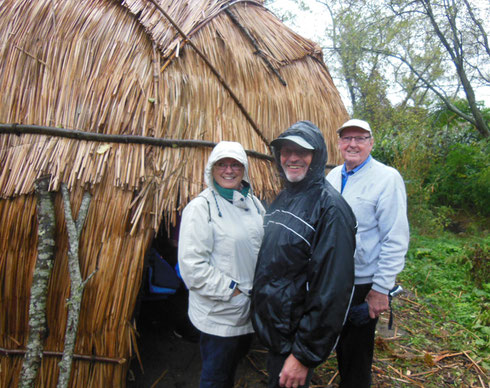 Three Wet Passengers are about to Enter a Wampanoag Hut at Plimoth Plantation