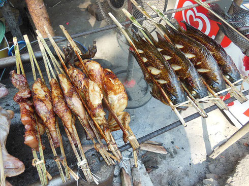 2015 Grilled meats and fish sold by vendors at a tiny village at the entrance to the falls