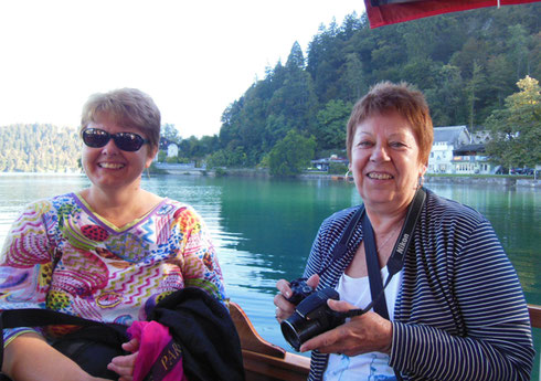 These Two Take a Break from Photography on the Pletna Ride to Lake Bled Island