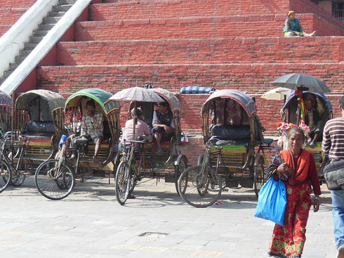 2013 A Line of Rickshaws are ready for hire at Durbar Square in Kathmandu