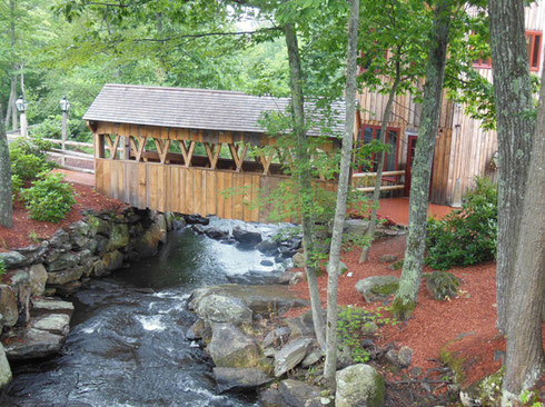 The Entrance to the 1761 Old Mill Restaurant is via this small Covered Bridge