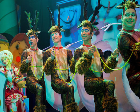 Cast members pose as reindeer in the Cirque Dreams Holidaze show