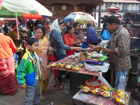 2013 Vendors sell a Variety of Offerings for Presentation at the Temples in Durbar Square