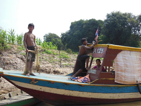 2015 This Cambodian Man and his Family on their Fishing Boat at Kompong Phhluk