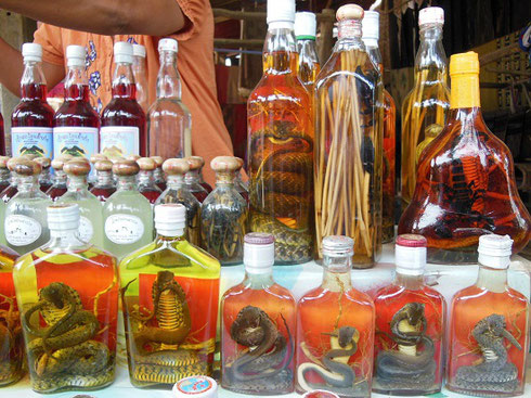 2015 For sale in the little village is Rice Wine with Snakes and Scorpions - good for virility