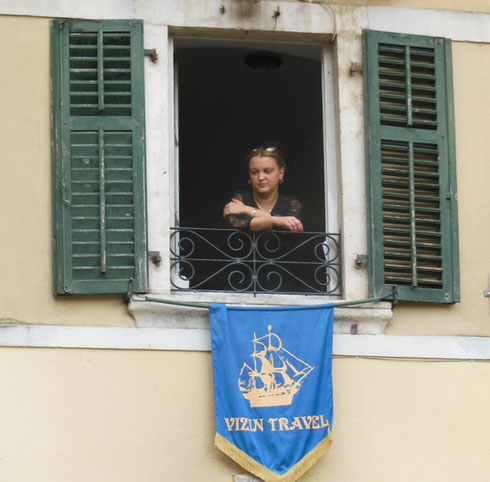 One of the Local Women Looks Quietly out her Window in Montenegro