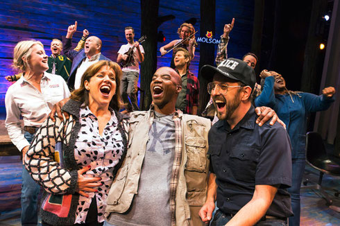 The cast of Come from Away laughing and singing