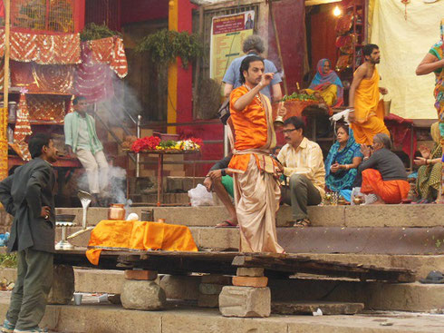 2013 A Priest Performing a Ceremony on the Steps of the Ganges in Varanasi