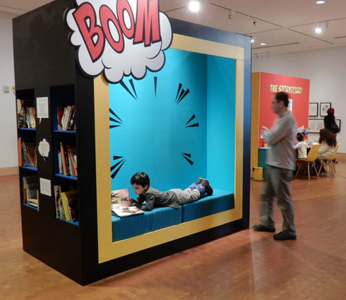 A Young Reader Gets Comfortable in a Nook at the Eric Carle Museum in Amherst