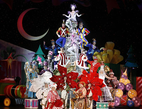 Lavish costumes  as the performers form a live Christmas Tree