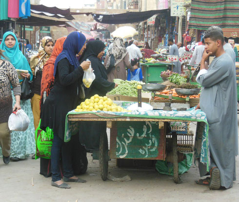 2016 A View of Local Women Purchasing Vegetables at the Open Market in Aswan