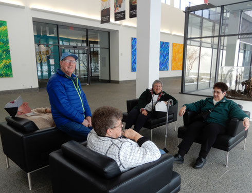 A group of our passengers found comfortable seating in the lobby of the Eric Carle Museum
