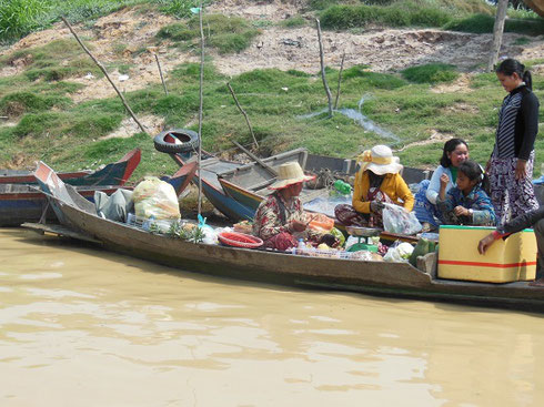 2015 A Fruit Vendor Sells from her Boat in Kompong Phhluk Village