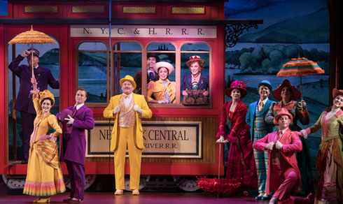 A group on the streetcar set of Hello Dolly!