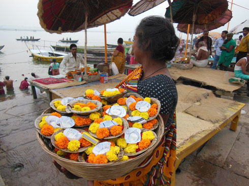 2013 Varanasi - A Vendor sells Candle Offerings to be Floated down the River Ganges