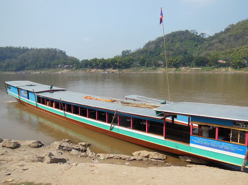 2015 We chartered this traditional Riverboat up the Mekong to the Pak Ou Buddhist Caves