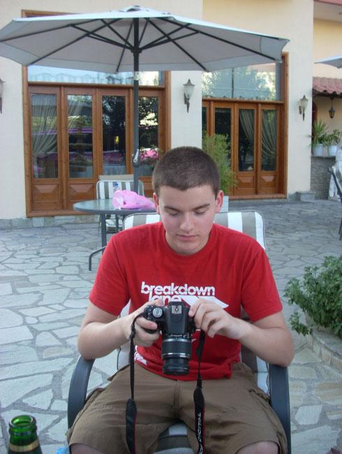 2011 Kalambaka - Our Youngest Passengers checking Photographs outside the Hotel Famissi