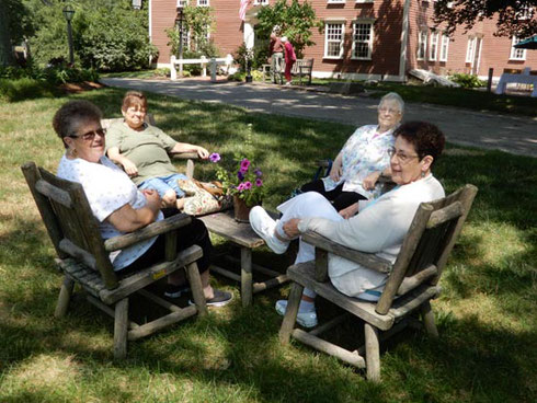 This Group Enjoyed the View of Wayside Inn's Gardens in a Comfortable Shady Setting
