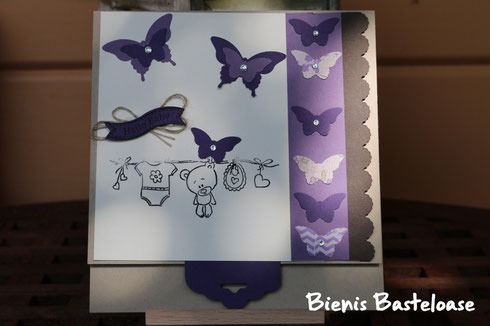 Eine Karte zur Geburt mit Schmetterlingen